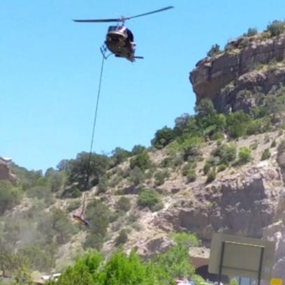 A U.S. Border Patrol helicopter  maneuvers a rescue
