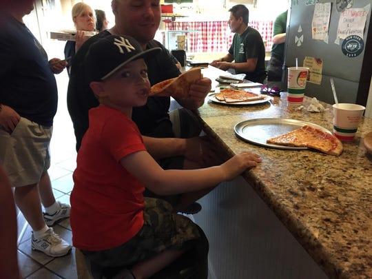 Jaxon Mucci, 4, enjoys a slice of cheese pizza at Hickory Tree Pizza in Chatham, during the Daily Record Summer Pizza Tour on May 30, 2015.