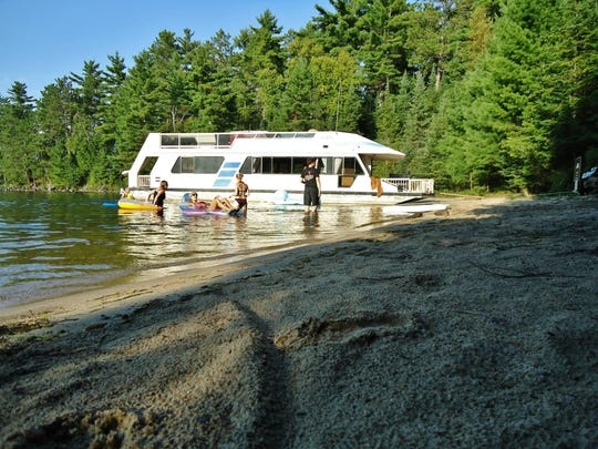 Houseboaters take a break to enjoy the water within Voyageurs National Park on Minnesota's border with Canada.