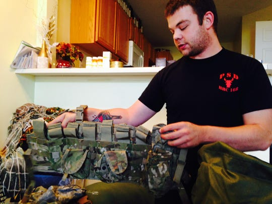 Ryan O'Leary shows an ammunition belt he was packing at his West Des Moines apartment before leaving for Iraq last month.
