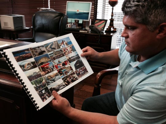 Alexandria Mayor Jacques Roy looks over a picture page in the RADD consortium's proposal for development of the downtown riverfront area. While consideration of the group's plan is still in the early stages, Roy said it offers a lot of potential to bolster development of downtown.