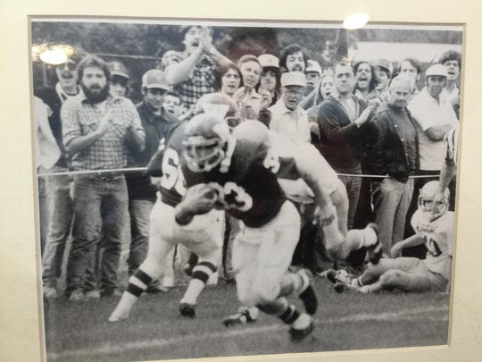 Glenn Cummings runs with the ball as a member of the Winooski High School football team in the late 1970s.