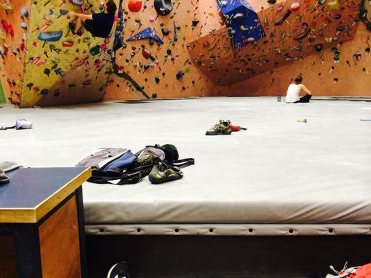 Climbers hang out at the bouldering wall at Earth Treks in Timonium, Md.
