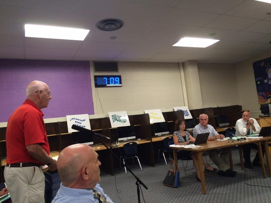 "Bob Walsh, a retired South Burlington High School teacher, shares his concerns Wednesday regarding the ""Rebels"" mascot with the School Board."