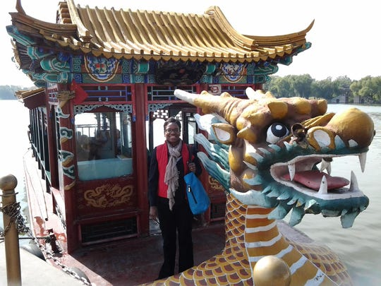 Cynthia Ward on a boat in China during a Greater Lansing Chamber of Commerce trip in 2013.