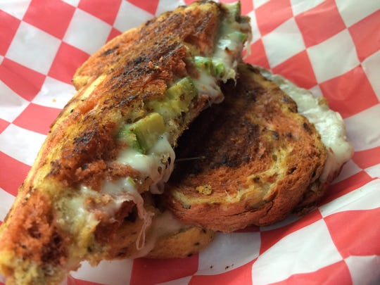 The Avocado Four Cheese grilled cheese on sundried-tomato bread, aka The Alton Brown Ate Here, from 11:Eleven Cafe.