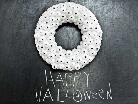 """Camille Smith, HGTV's managing editor, recommends this googly-eyed wreath as a fun one for kids: Cover a white foam wreath with pingpong balls garnished with small and large googly eyes. """"If you store it flat (so the balls don't dent), it never goes bad,"""" Smith said."""