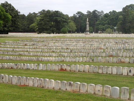UPPER PHOTO: Some of the nearly 13,000 graves of Union soldiers buried in Andersonville National Cemetery in Georgia. Disease, lack of adequate medical attention, unsanitary conditions, and poor diet led to a large number of deaths during the summer of 1864. The bodies were buried in trenches shoulder to shoulder, thus the minimal spacing between headstones. Vermonter Truman Naramore, who survived being an Andersonville prisoner, died in California in 1895 and is buried in Los Angeles.