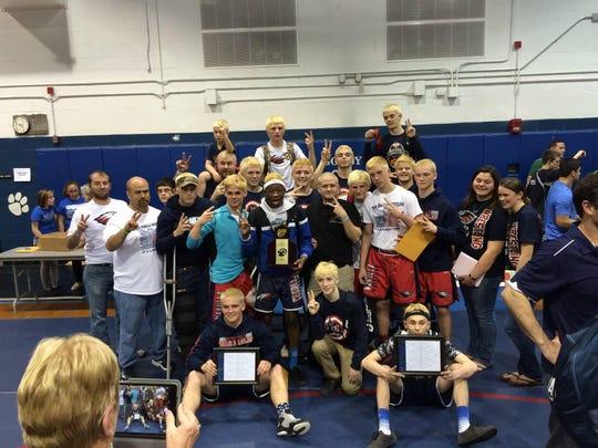 The Wakulla wrestling team won a region title last year.