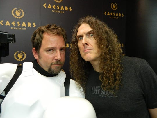 Mike Lica, in Stormtrooper costume, meets Wierd Al Yancovick. Lica and other members of the Great Lakes Garrison share the stage with Yancovick when he sings The Saga Begins whenever he's in town performing.