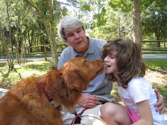 """Only a few minutes after meeting Rikki, Zoe had mastered the """"kiss"""" trick, holding a baby carrot bet ween her teeth as the dog gently retrieved it."""