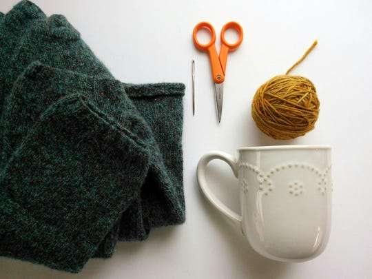 Turn an old felt sweater into a cozy for your coffee mug.