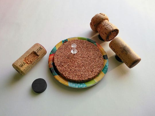 Mini corkboards and wine cork magnets are easy crafts to organize notes on the fridge.