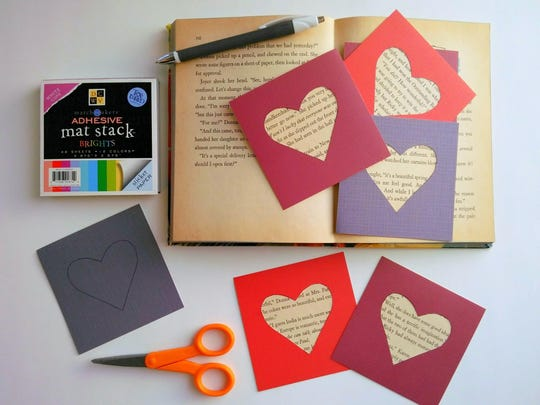 Cardstock Sticker Paper and an old book you are good with cutting up make these fun valentines.