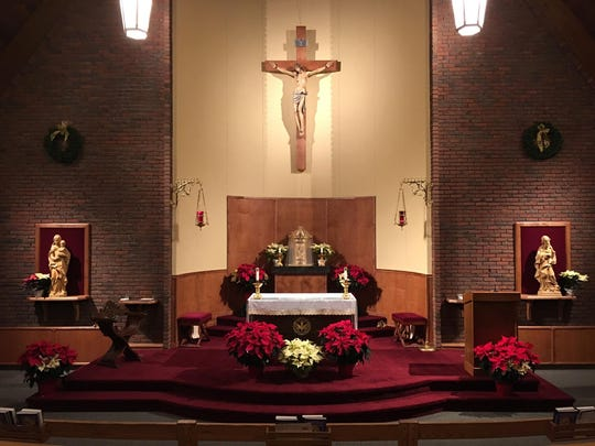 A modern view of the inside of the chapel at the Catholic Center.