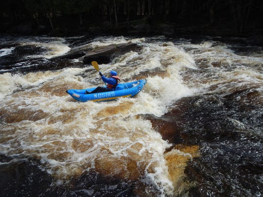 A kayaker battles the First Drop rapid on the Peshtigo River in a funyak, an inflatable kayak, from Kosir's Rapid Rafts.