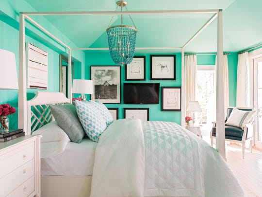 This bedroom featres the television creatively mounted on the wall that keeps it from standing out too much or detracting from the design of the rest of the room.