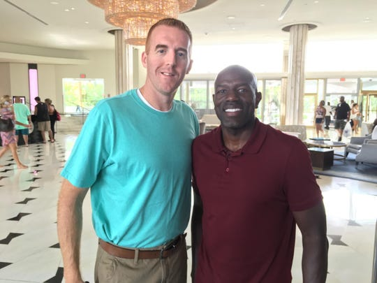 Haywood boys basketball head coach Oliver Simmons and former Haywood basketball player Tony Delk pose for a photo. Both were part of the 1995-96 Kentucky basketball national championship team.
