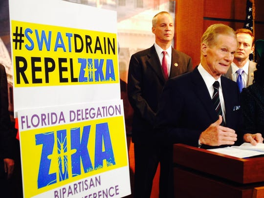 Sen. Bill Nelson, D-FL, speaks Tuesday during a news conference on Capitol Hill where bipartisan members of Florida's congressional delegation urged passage of legislation to fund anti-Zika efforts. Behind him are Rep. Curt Clawson, R-Bonita Springs, (left) and Rep. Patrick Murphy, D-Jupiter.