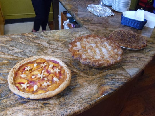 Peach pies on display with winner Renee Krell's pie on the left.