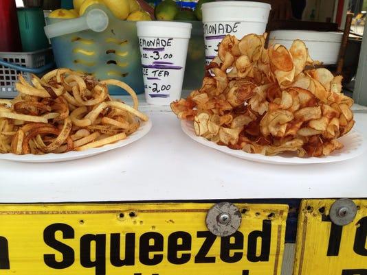 The Tornado Potato (right) at the Texas-Oklahoma Fair and the lesser potato dish, the fries (left).