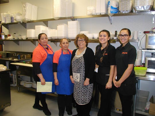 Owner Martha Muniz credits the transition two years ago and the ongoing success of her restaurant to her staff of 20 employees and the support of the Cutler-Orosi community. Cooks and servers flanking Martha in the kitchen are, from left, Betha Quezada, Rebecca Carillo, Blanca Pena and Xenia Freeman.