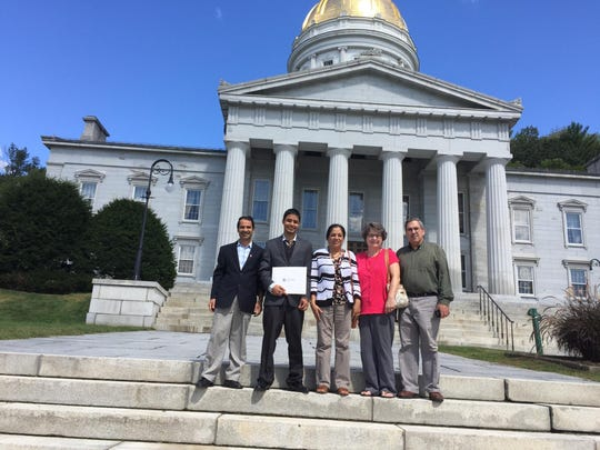Abi and Mon Chamlagai pose with their son and Jan and Bob Battaline on the Statehouse steps in Montpelier after the Chamlagais' son was naturalized.