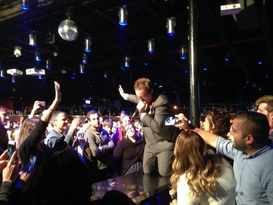 Lead singer Paul Janeway came off the stage and into the audience during his band's last gig in town during Dec. 2015. Expect more of the same when St. Paul and the Broken Bones returns to The Moon on Saturday night.