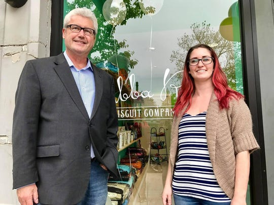Mayor Tim Dougherty and Bubba Rose Biscuit Company owner Amanda Smith at the grand opening of her Morristown store on May 20.
