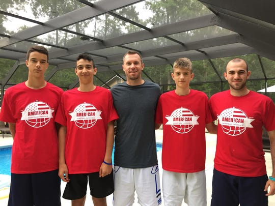 Former Florida High star Brett Blizzard, center, with three Italian youth players and Italian coach Alssandro Susino, right.