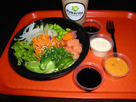 This bowl of healthy eats has cubed salmon and tuna, rice, edamame, onion, cabbage, lettuce, jalapeno and avocado. Of the sauces, the darker colors are soy-based sushi sauce and poke dressing; the white one is yum yum and orange is spicy mayo. The beverage is boba, a milk tea with tapioca pearls.