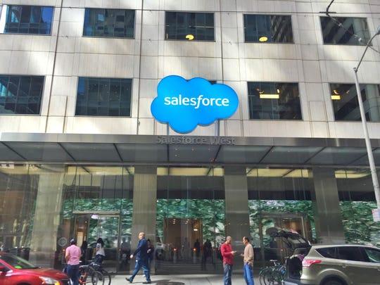 The Salesforce logo above a building entrance.