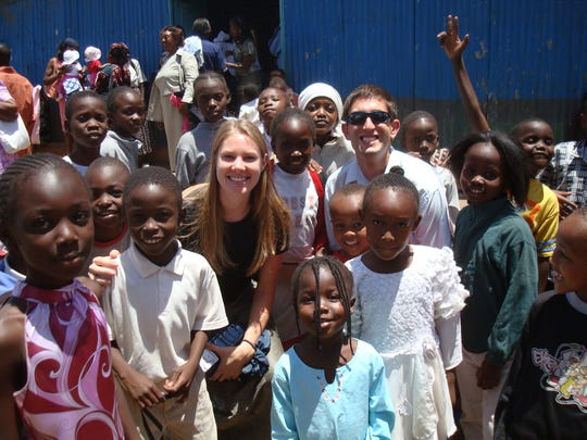 Jason and Jalina Reinhardt are pictured making friends in Kenya during a 2008 mission trip.