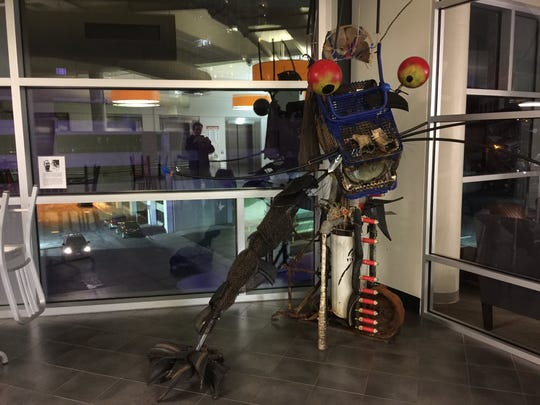 """""""River Spirit,"""" featuring materials pulled out of the Raritan River and assembled by Christopher Carter Sanderson, commissioned by coLAB Arts in partnership with the Lower Raritan Watershed Partnership and installed in New Brunswick's Wellness Center Parking Deck."""
