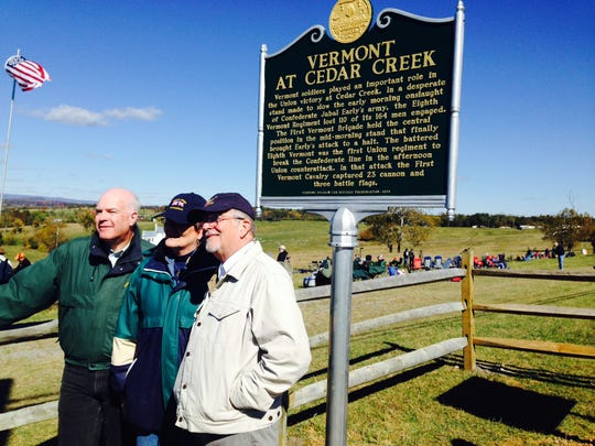 From left: State Sen. Joe Benning, Pat McDonald of Berlin and Civil War historian and author Howard Coffin pose at the new Vermont marker at Cedar Creek Battlefield in Middletown, Virginia.