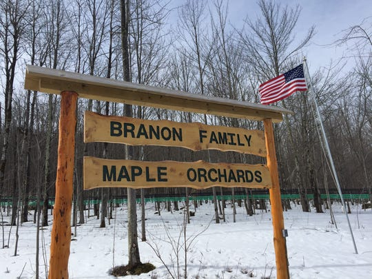 A rustic sign welcomes visitors to the Branon Family Maple Orchards in Fairfield on Maple Open House Weekend.