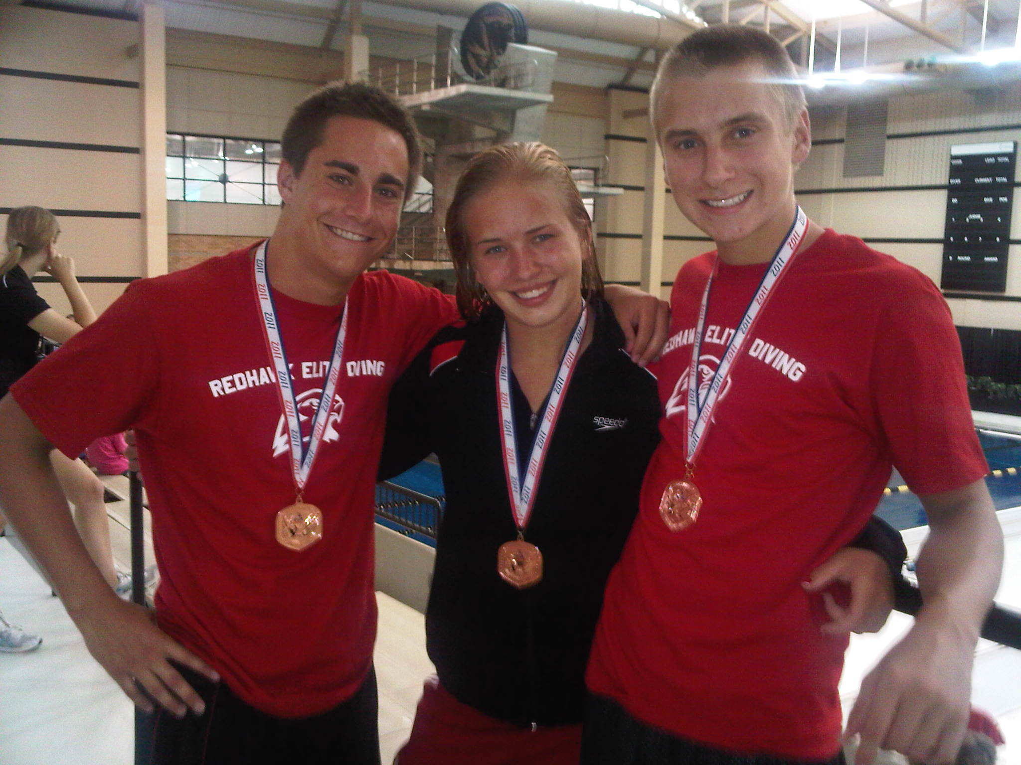 From left: Justin Youtsey, Carly Scheper and Logan Stevens, in a file photo, are now diving in college where all three competed in the NCAA Division I national championships in March.
