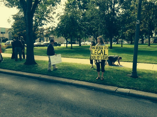 About two dozen people from New Beignnings Ministries in Warsaw were protesting the Coshocton County Sheriff's Office on Monday. The protests stemmed from Pastor Bill Dunfee and another man being arrested and charged with criminal trespassing Friday at the Foxhole North strip club.