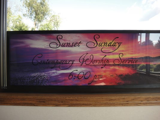 COS sunset service sign