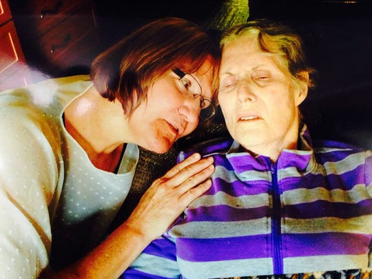 This photo shows Linda Dunshee with her mother, Donna Rayhons, shortly before Rayhons died last August. The photo was introduced as evidence Friday in the sex-abuse trial of Rayhons' husband, Henry Rayhons.