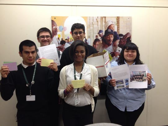 Students from Detroit Cristo Rey Catholic High School hold some of the several hundred letters they gathered from Catholic school students inviting Pope Francis to visit Detroit in 2015. The students were meeting Friday, Nov. 14, with aides to Mayor Mike Duggan in the mayoral offices. Front row, from left to right: Eduardo Garduno, 16, Kourtney Ross and Juanita Zuniga, both 15. In the back row are Richard Straksys and Ali Alwan, both 16.