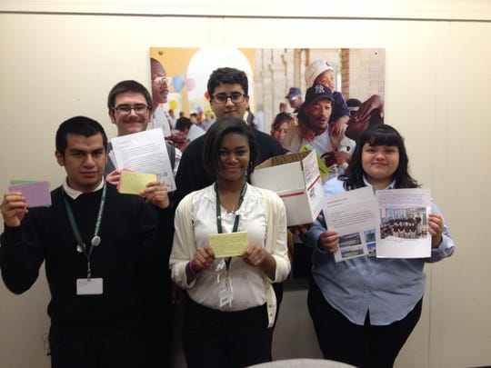Students from Detroit Cristo Rey Catholic High School hold some of the several hundred letters they gathered from Catholic school students inviting Pope Francis to visit Detroit in 2015. The students were meeting Friday, Nov. 14, with aides to Mayor Mike Duggan in the mayoral offices. Front row, from left to right, are Eduardo Garduno, 16, a junior; and Kourtney Ross and Juanita Zuniga, both 15 and sophomores. In the back row are Richard Straksys and Ali Alwan, both 16 and juniors.