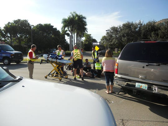A male bicylist is being taken to the hospital after being hit by a car on College Parkway.