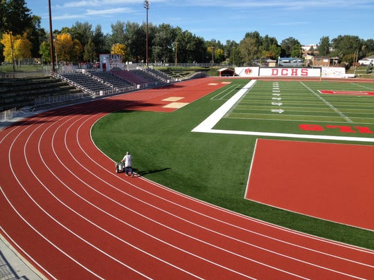 Stripes are applied at the Glendive track. The complex now features an NFL-caliber football field and international-level track.