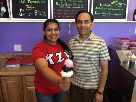 Komal Das, left, with her father Pankaj, holds a vanilla, coffee and strawberry cone.