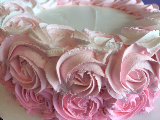 Roses adorn an ice cream cake.