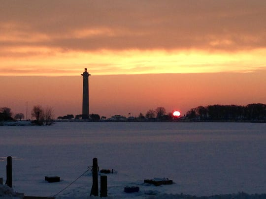 The sun rises at Put-in-Bay, where the harbor is ice-covered. At left is Perry's Victory and International Peace Memorial. The Rev. Mary Staley of St. Paul's Episcopal Church at Put-in-Bay is chronicling picturesque scenes like this one, with photos. For more photos, see our Life on Lake Erie page A4.