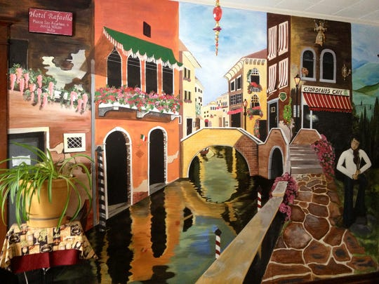 A hand-painted mural of Venice painted by Deborah Pufnock.