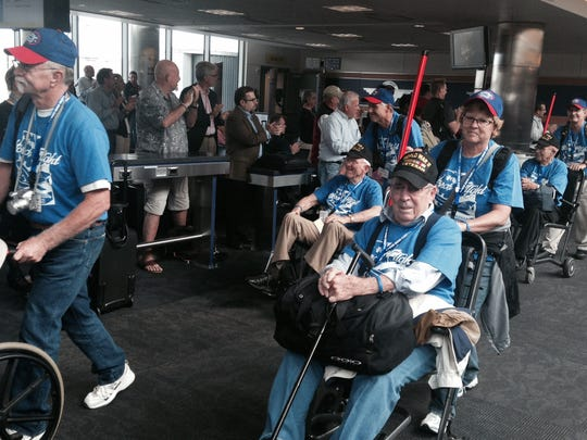Utah Honor flight participants – 26 World War II veterans in all -– pass by an adoring throng of airport goers Tuesday after the UHF contingent landed in Baltimore.