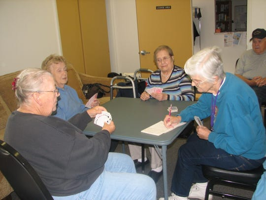 Visitors at the Cedar City Senior Center play cards together. Approximately 789 senior citizens in Iron County are facing the loss of their Medicare Advantage plan.